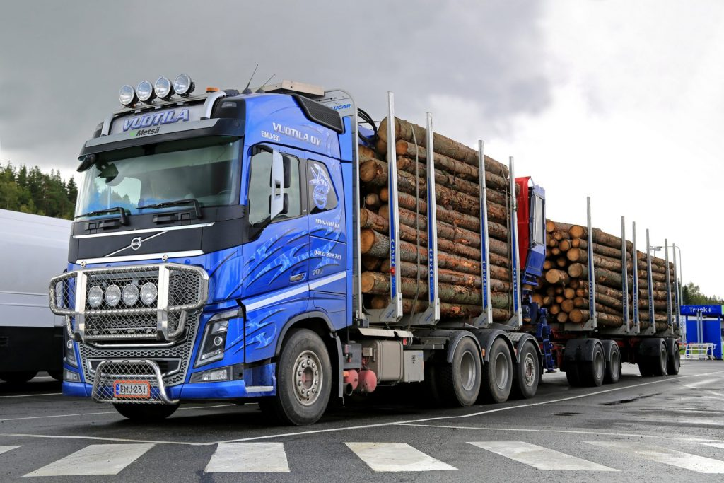 Timber truck with log trailer